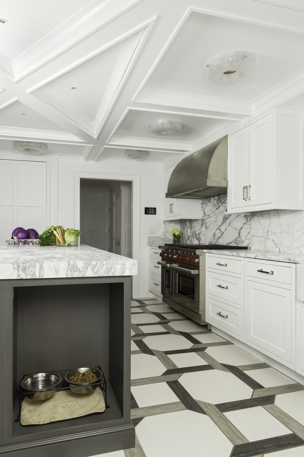 Transitional style kitchen with custom built storage on kitchen island