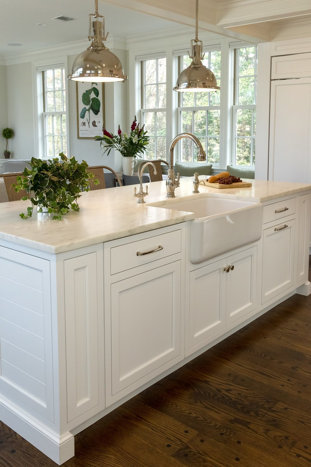 Transitional style kitchen with built in island drawer