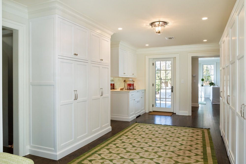 Transitional style kitchen with carpeted floor and large cabinet