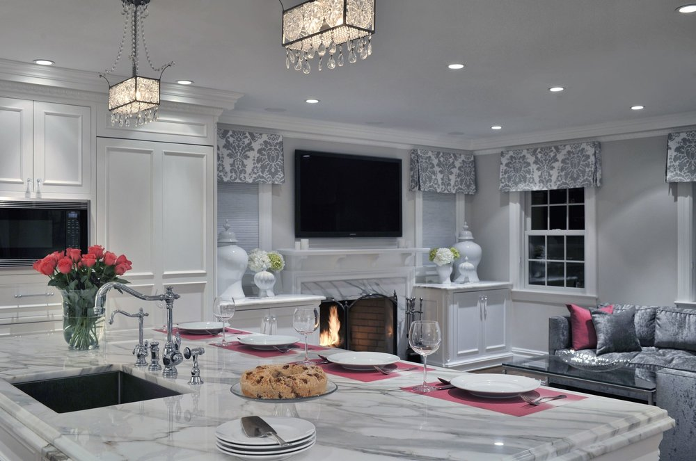 Transitional style kitchen with marble countertop