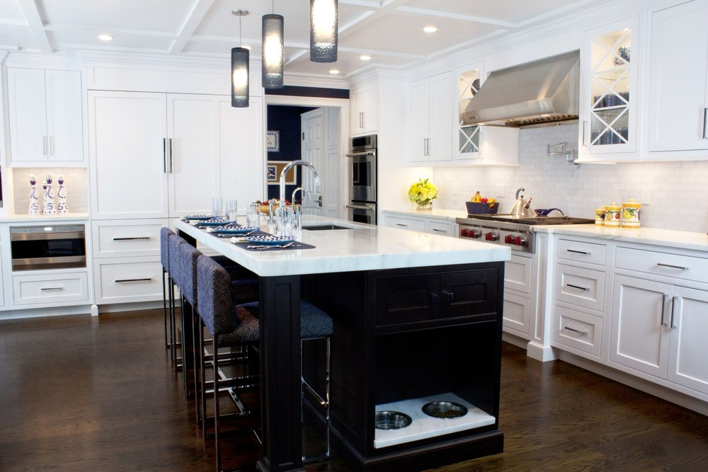 Transitional style kitchen with accented wooden storage