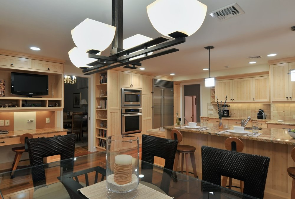 Transitional style kitchen with modern light fixtures