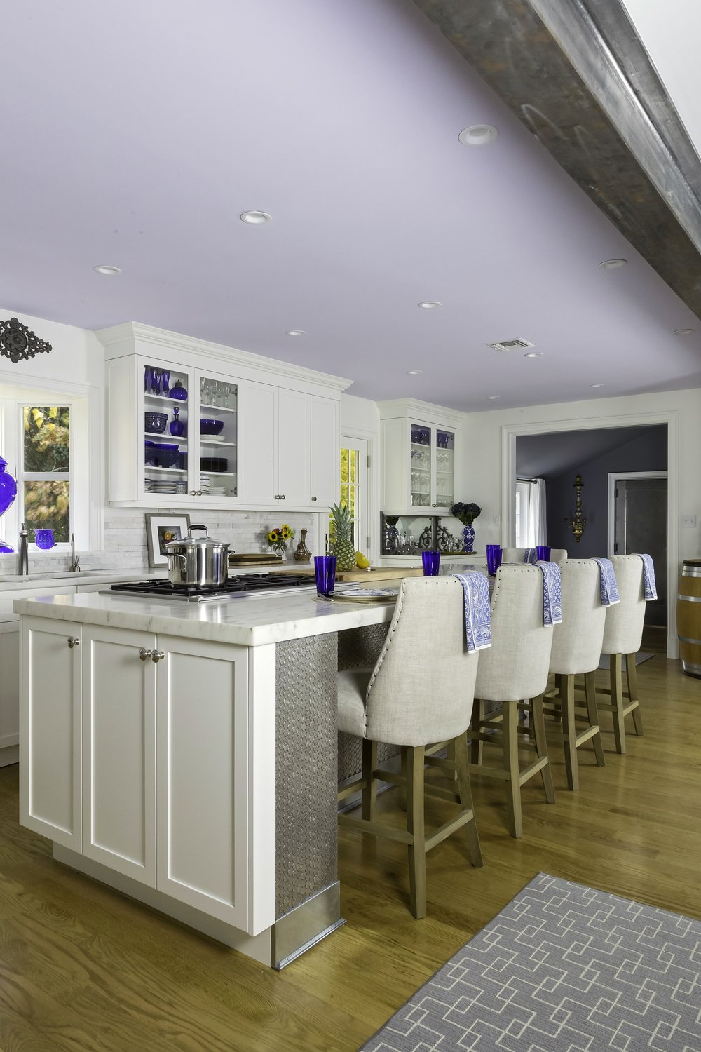 Transitional style kitchen with long kitchen counter