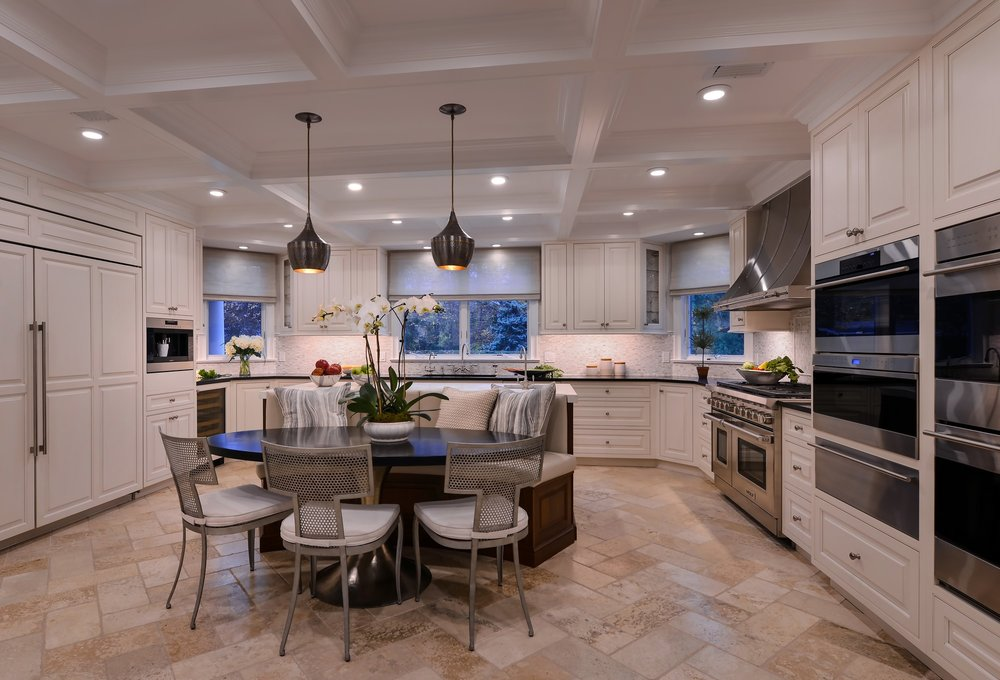 Transitional style kitchen with light colored tile