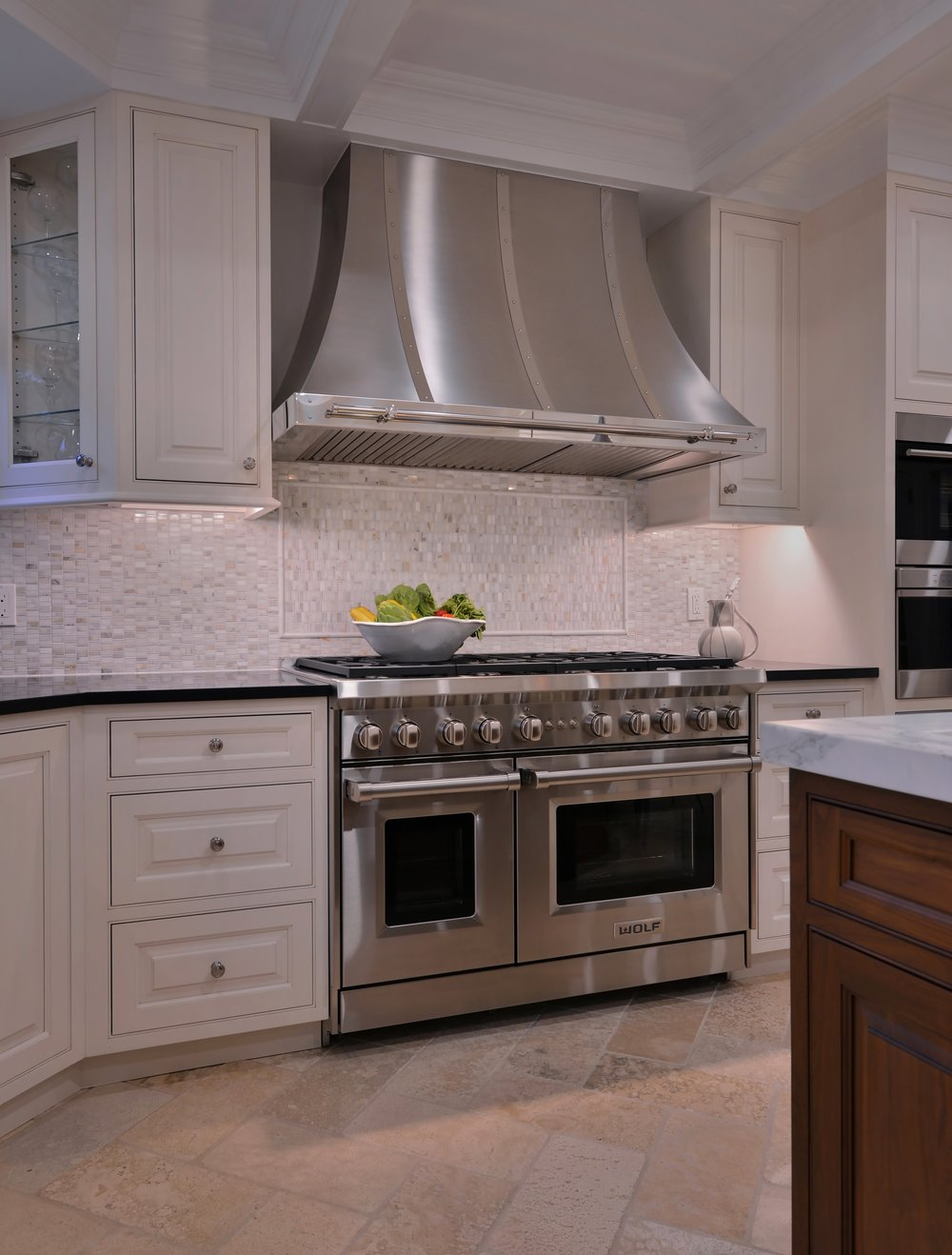Transitional style kitchen with stainless steel range hood
