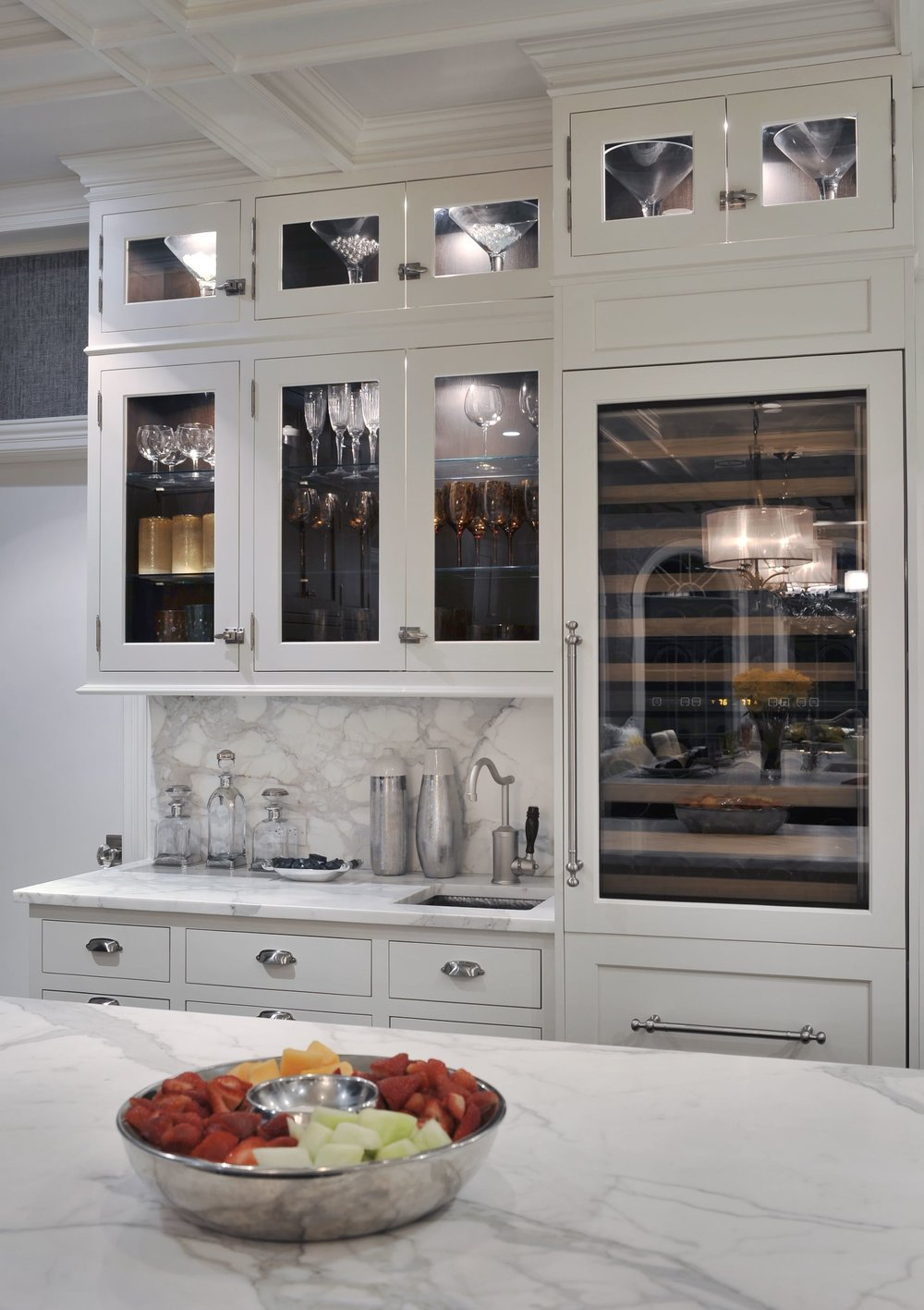 Transitional style kitchen with elegant wine glass cabinet