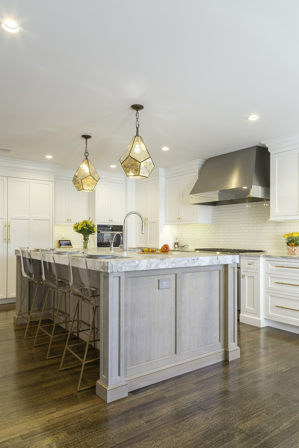 Transitional style kitchen with three counter stool