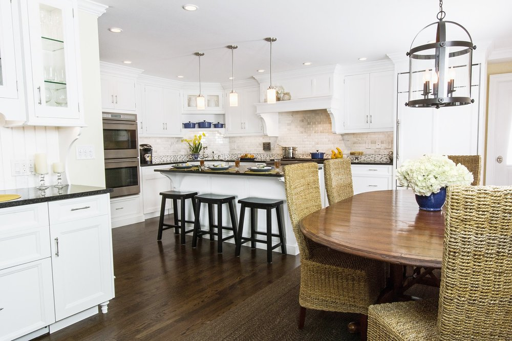 Transitional style kitchen with center island and breakfast table