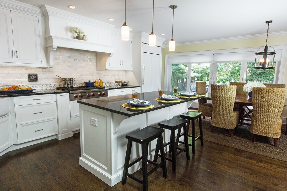 Transitional style kitchen with center island and counter stool