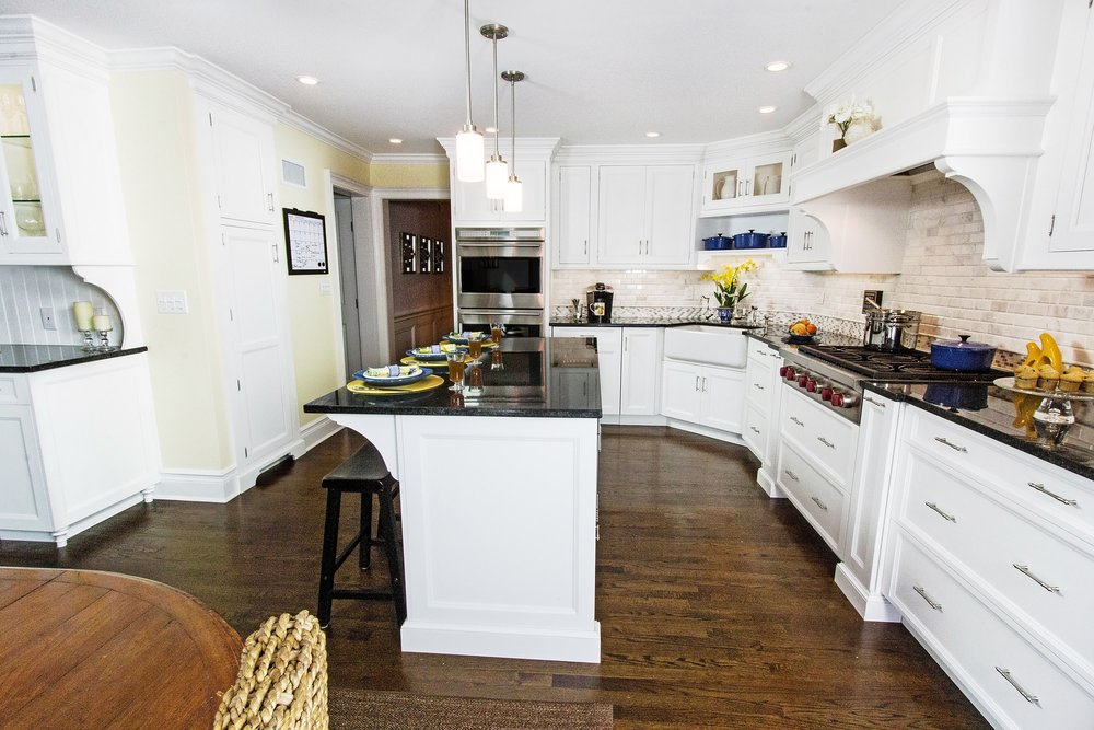 Transitional style kitchen with upper cabinet and open shelf
