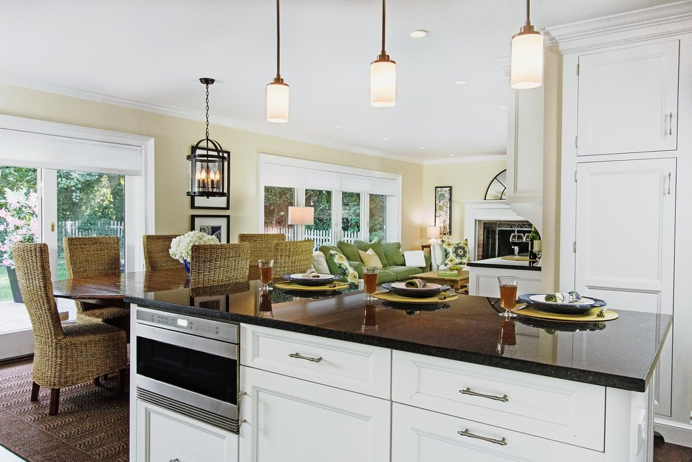Transitional style kitchen with speed cooking oven and pull out drawers