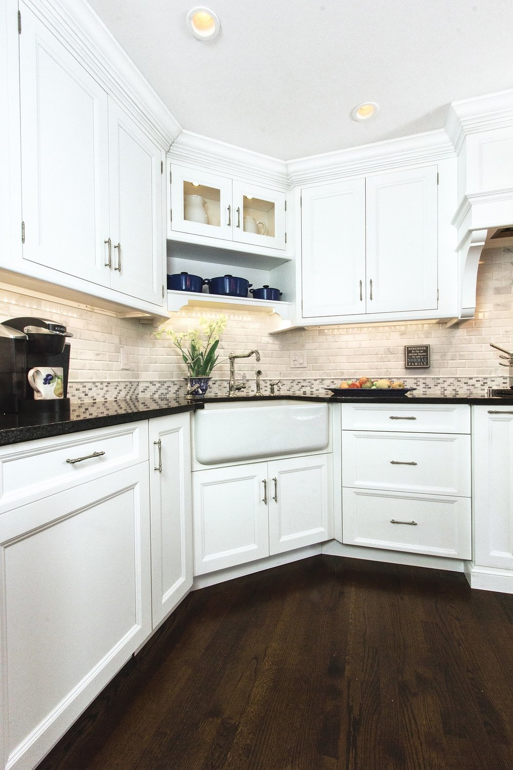 Transitional style kitchen with small glass door cabinet and open shelf