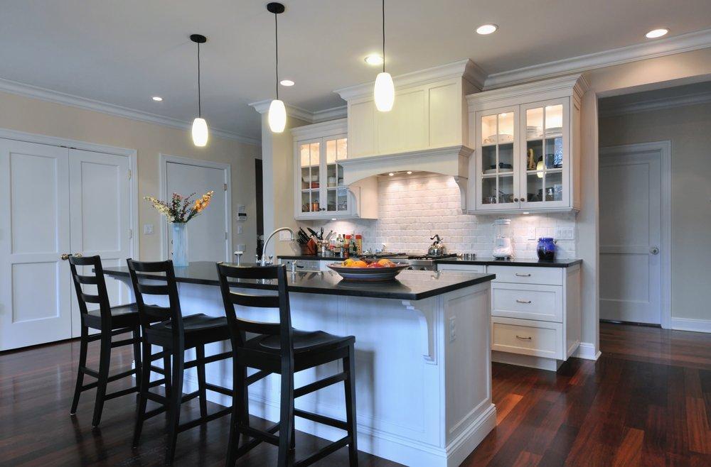 Transitional style kitchen with dark wooden floor