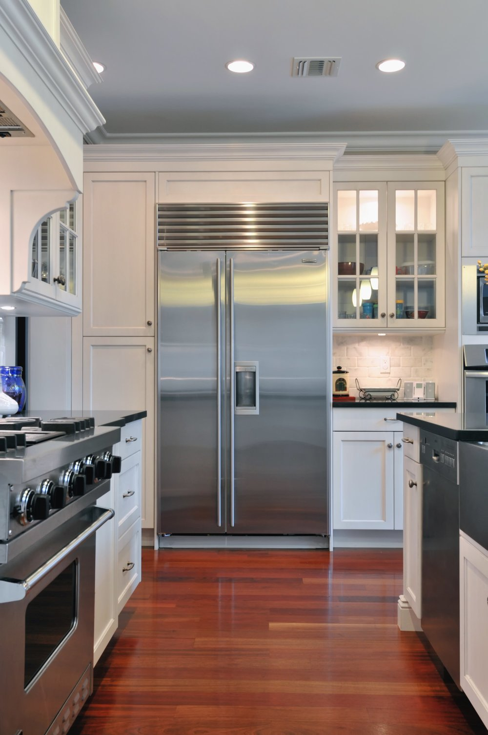 Transitional style kitchen with stainless steel oven