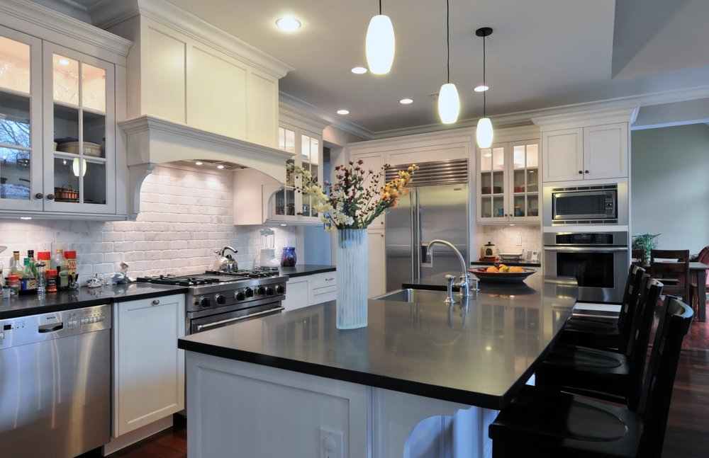 Transitional style kitchen with range hood and range oven
