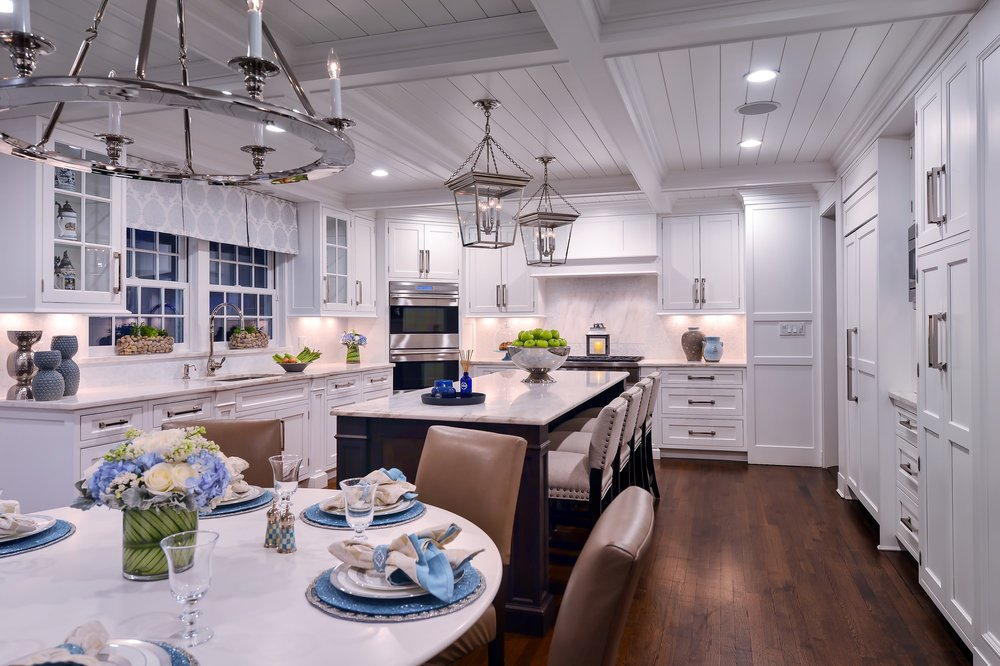 Transitional style kitchen with center island and a breakfast table