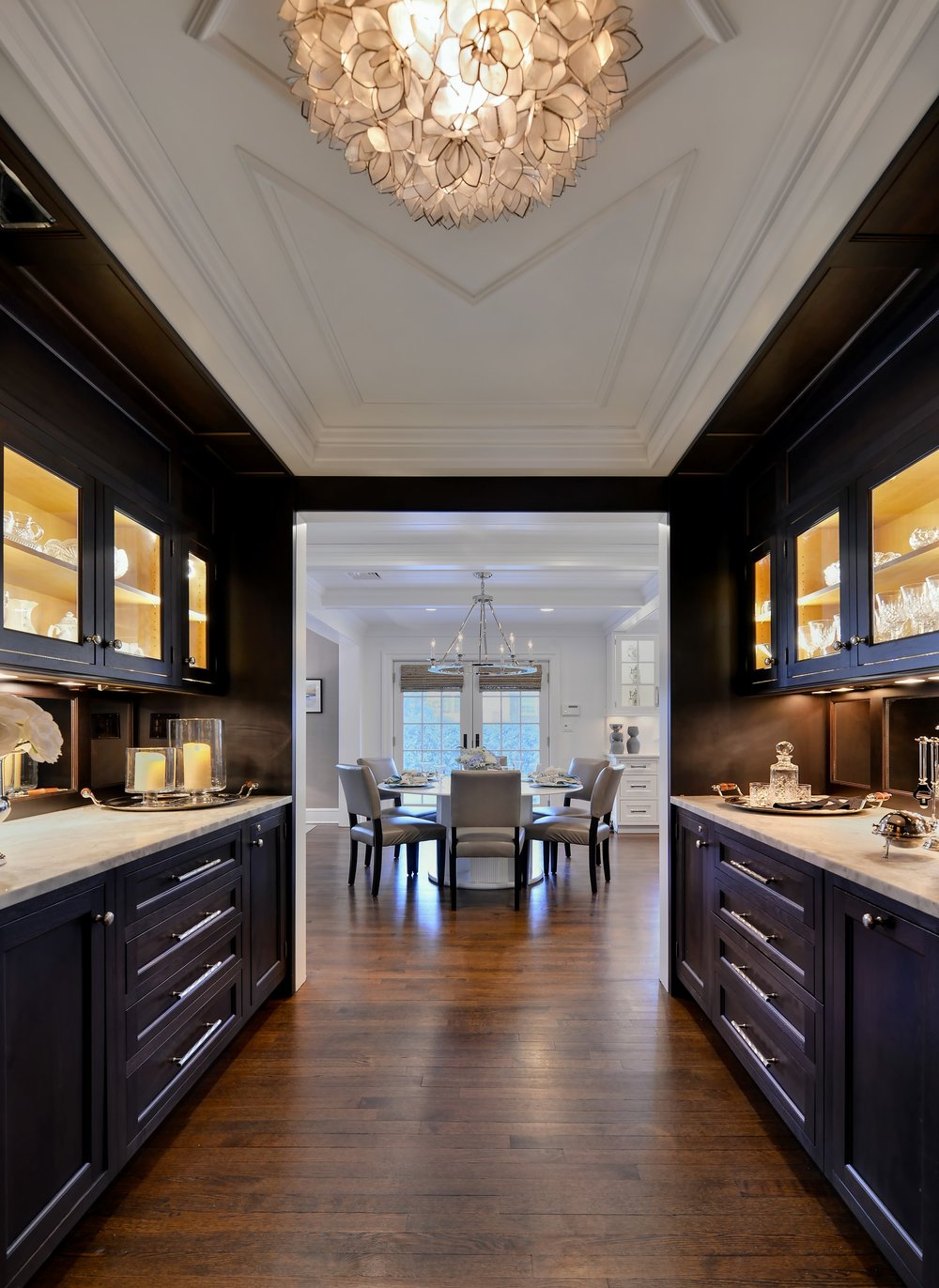 Transitional style kitchen with wine glass cabinets and drawers