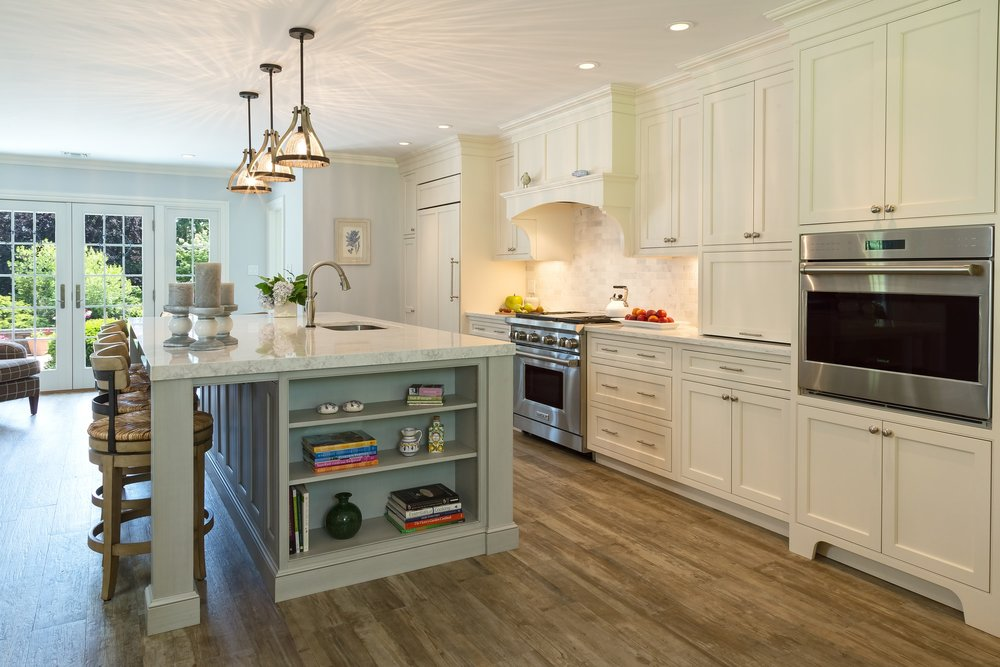 Transitional style kitchen with custom built shelves on kitchen counter