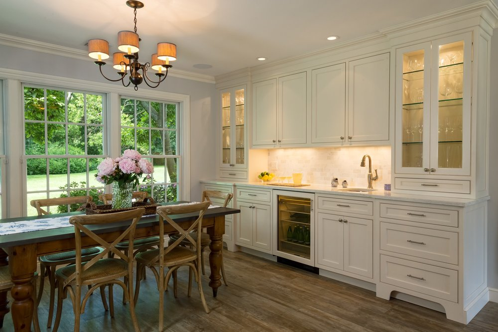Transitional style kitchen with large cabinet with drawers