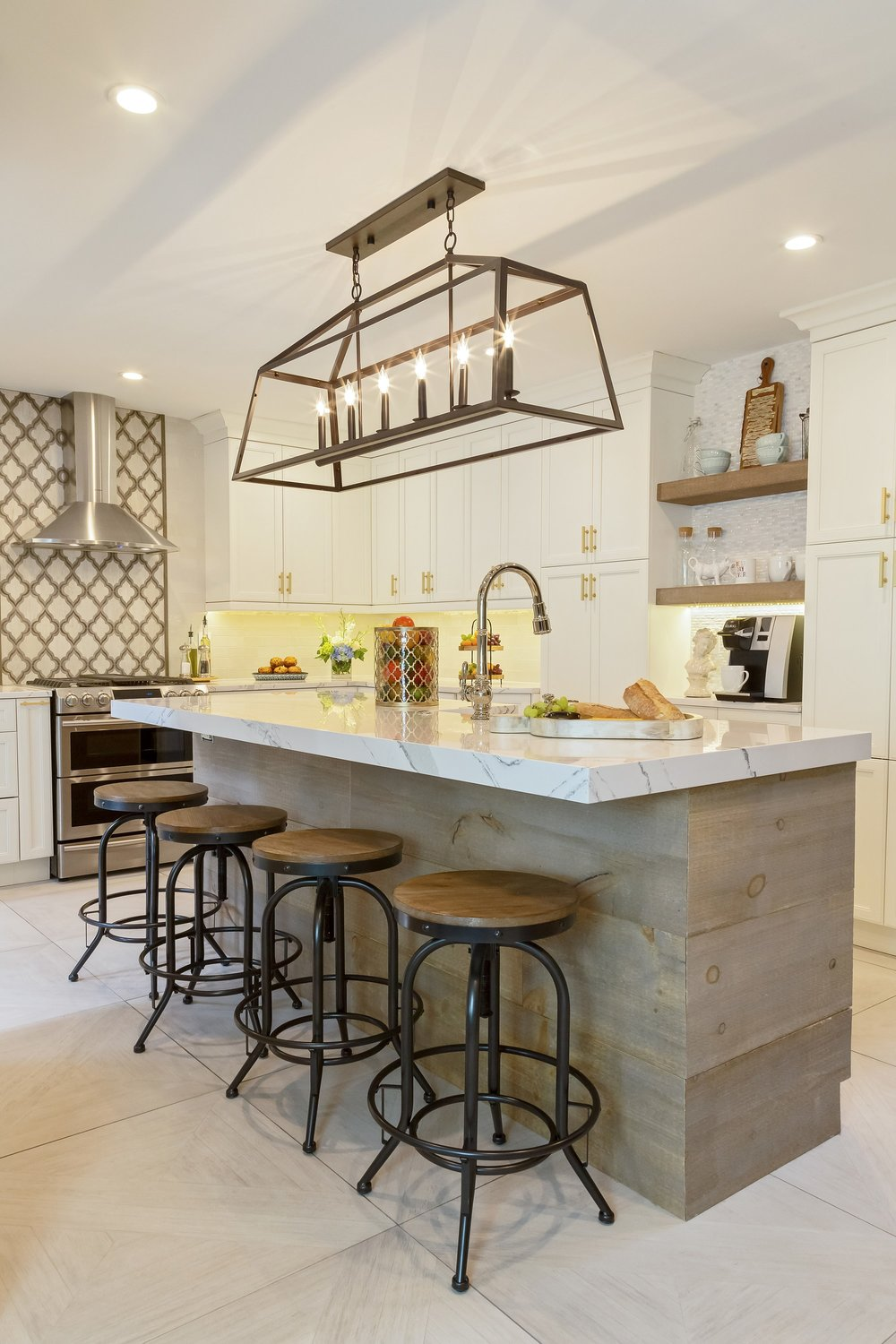 Transitional style kitchen with center island and counter stools