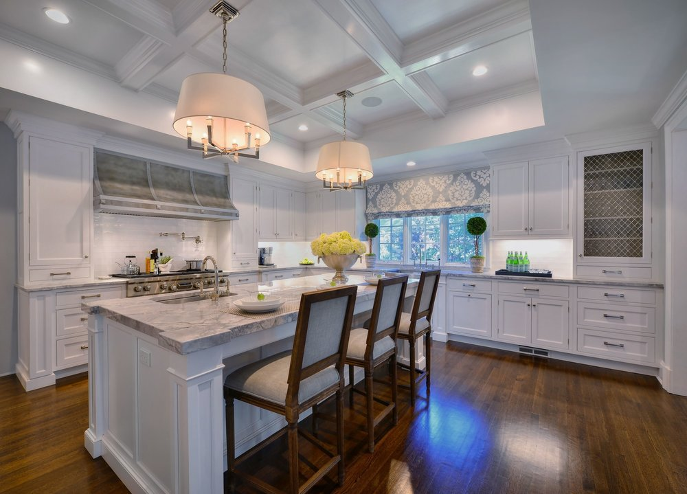 Transitional style kitchen with three counter stools at the kitchen counter