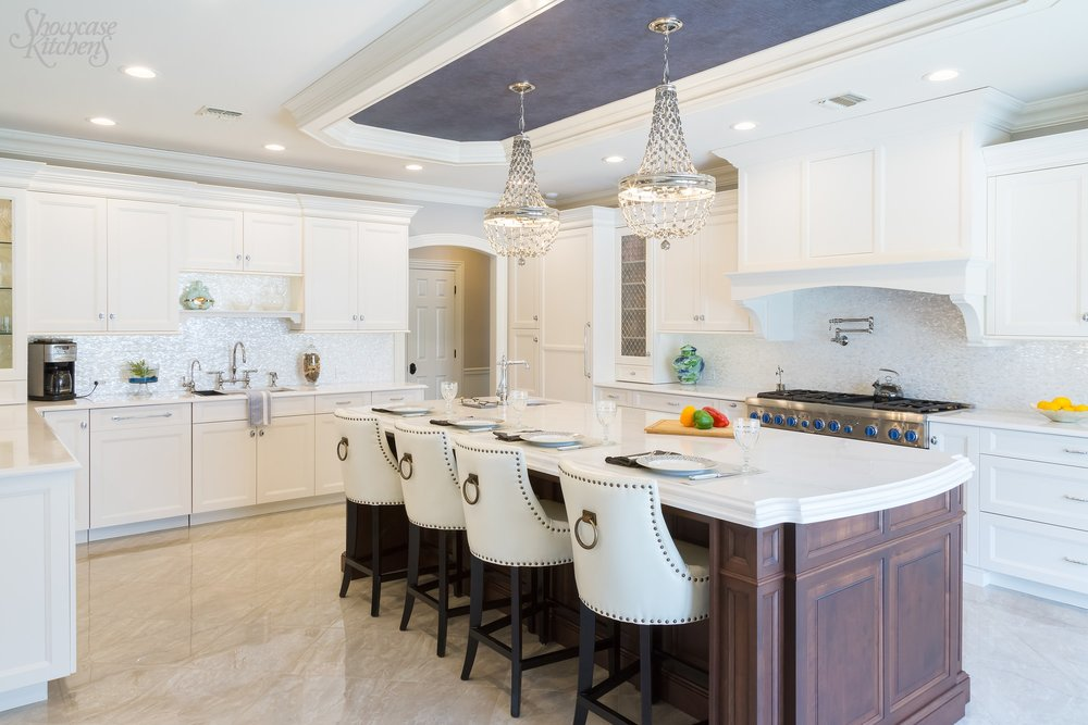 Transitional style kitchen with white floor and center island