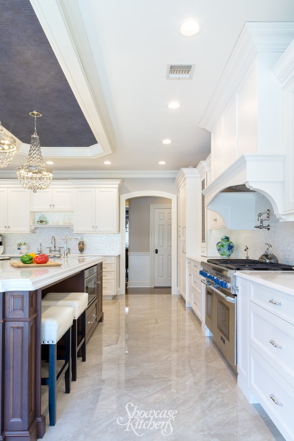 Transitional style kitchen with white marble floor