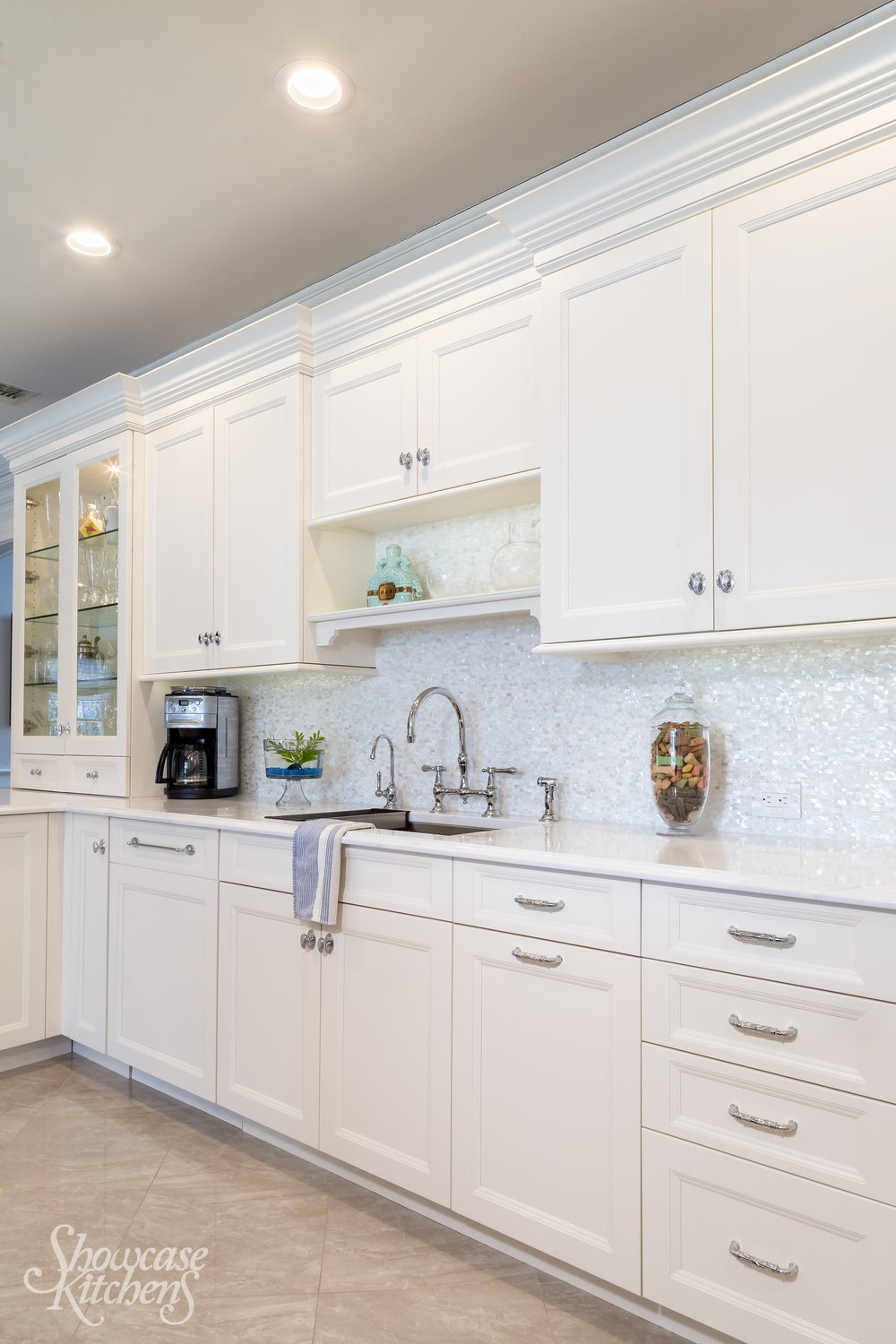 Transitional style kitchen with plenty of pull out and upper cabinets
