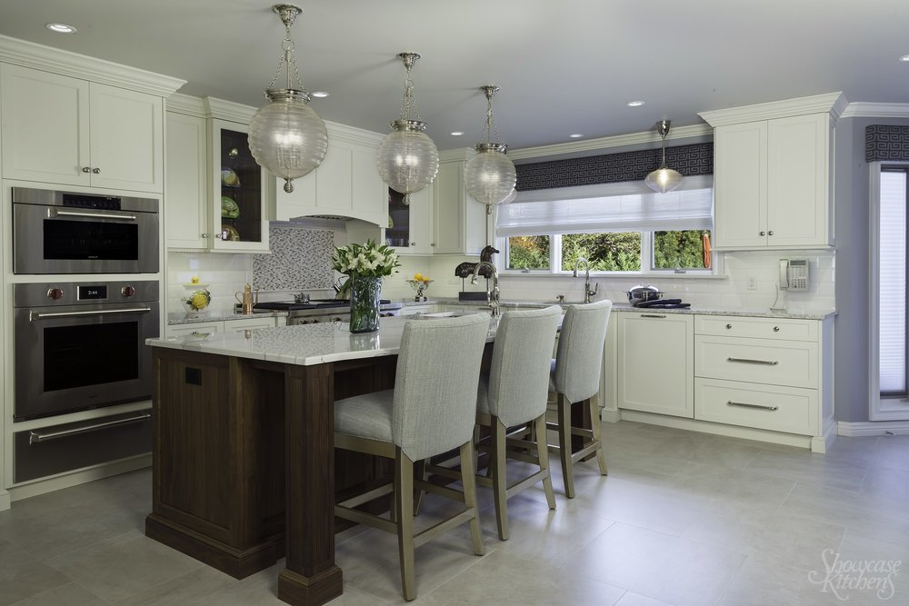 Transitional style kitchen with three round pendant light fixtures