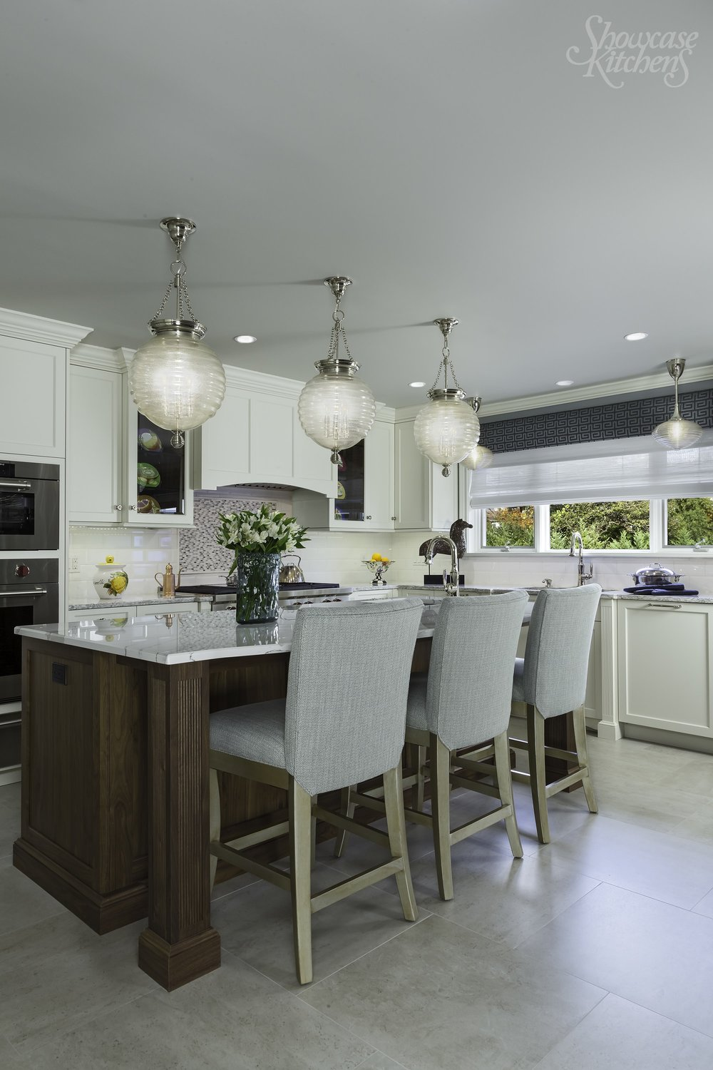 Transitional style kitchen with breakfast table and a stylish chandelier