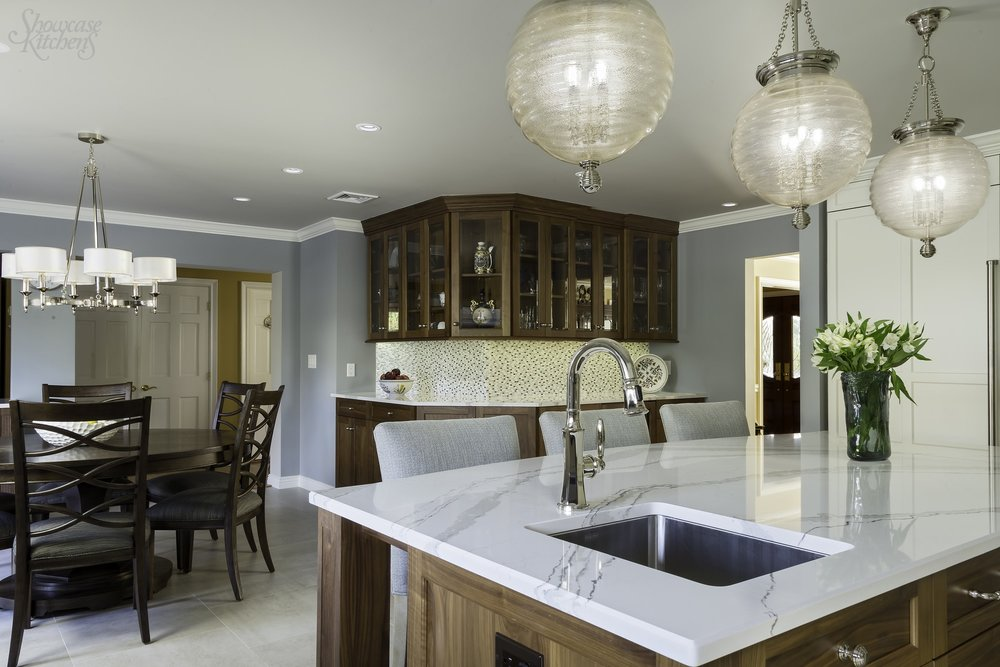 Transitional style kitchen with two glass door upper cabinets