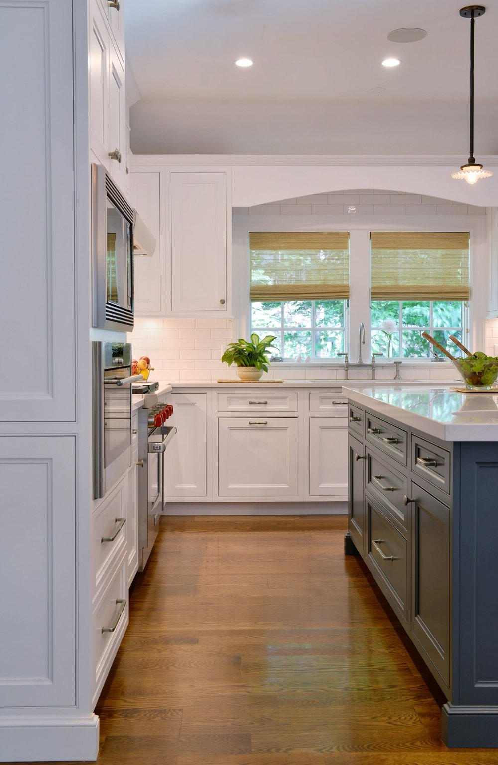Transitional style kitchen with two french windows