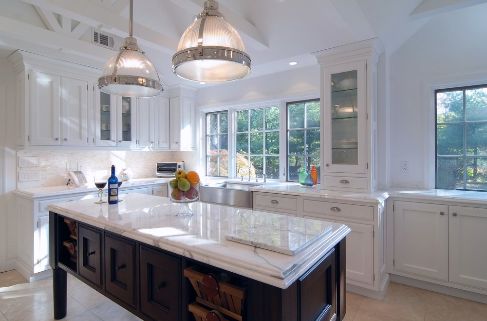 Transitional style kitchen with center island and marble countertop