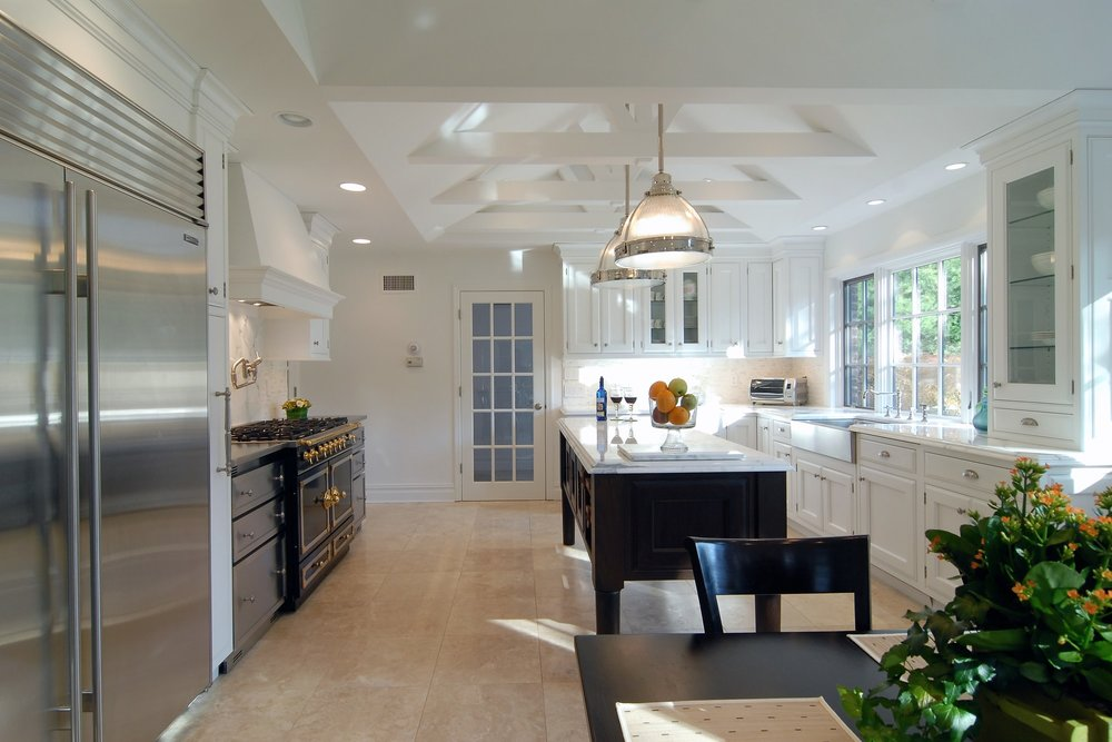 Transitional style kitchen with upper cabinets and pull up drawers