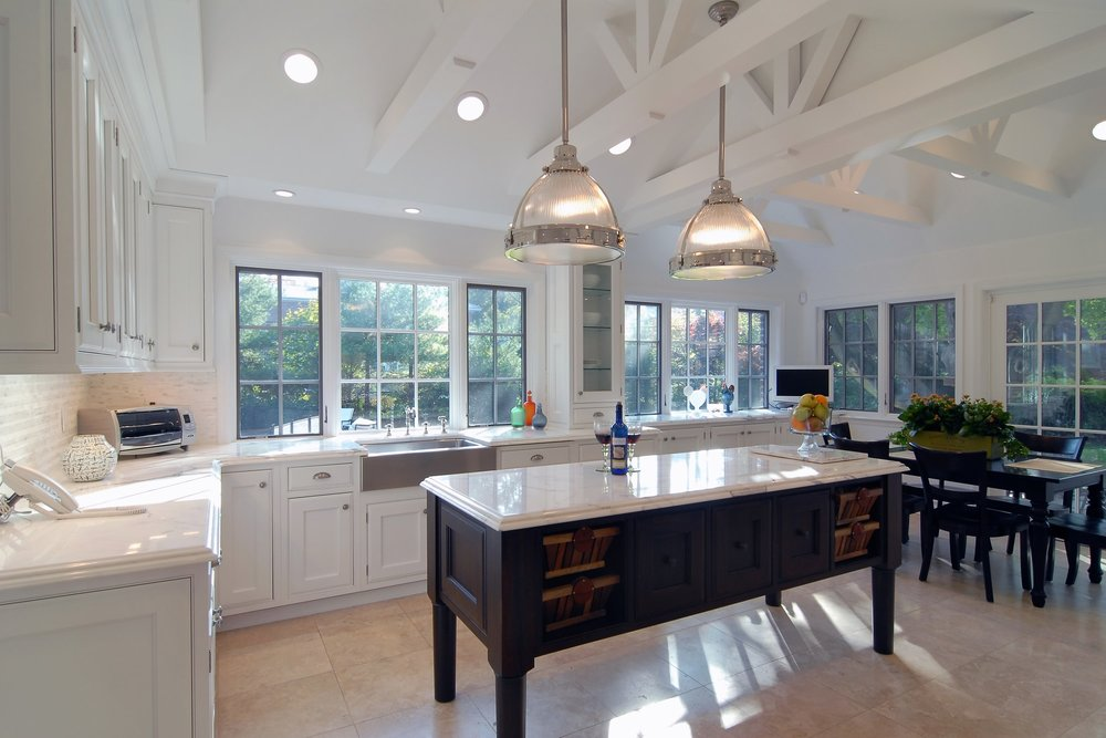 Transitional style kitchen with plenty of bay windows