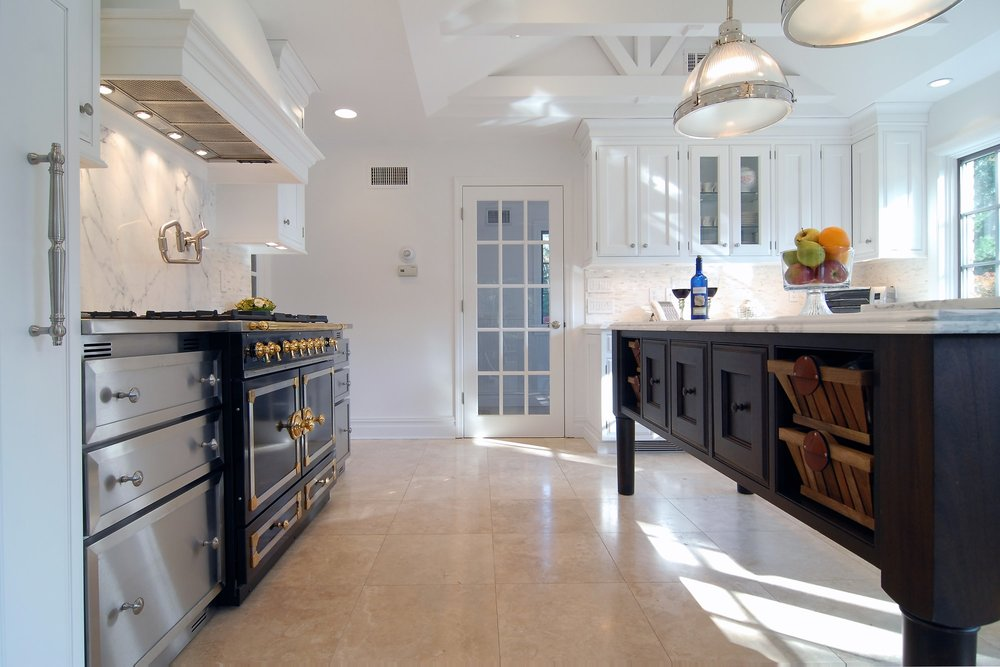 Transitional style kitchen with custom built under counter storage