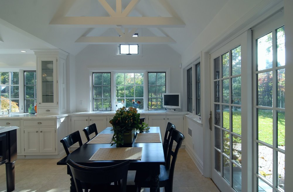 Transitional style kitchen with plenty of windows and a dining area