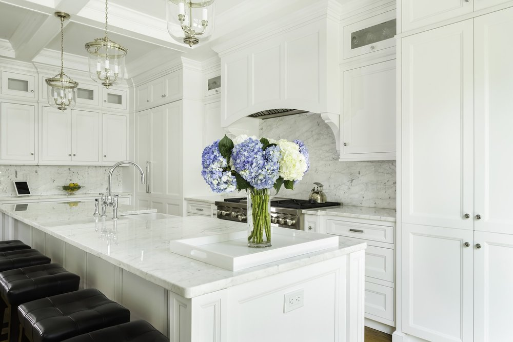 Transitional style kitchen with three pendant light fixtures