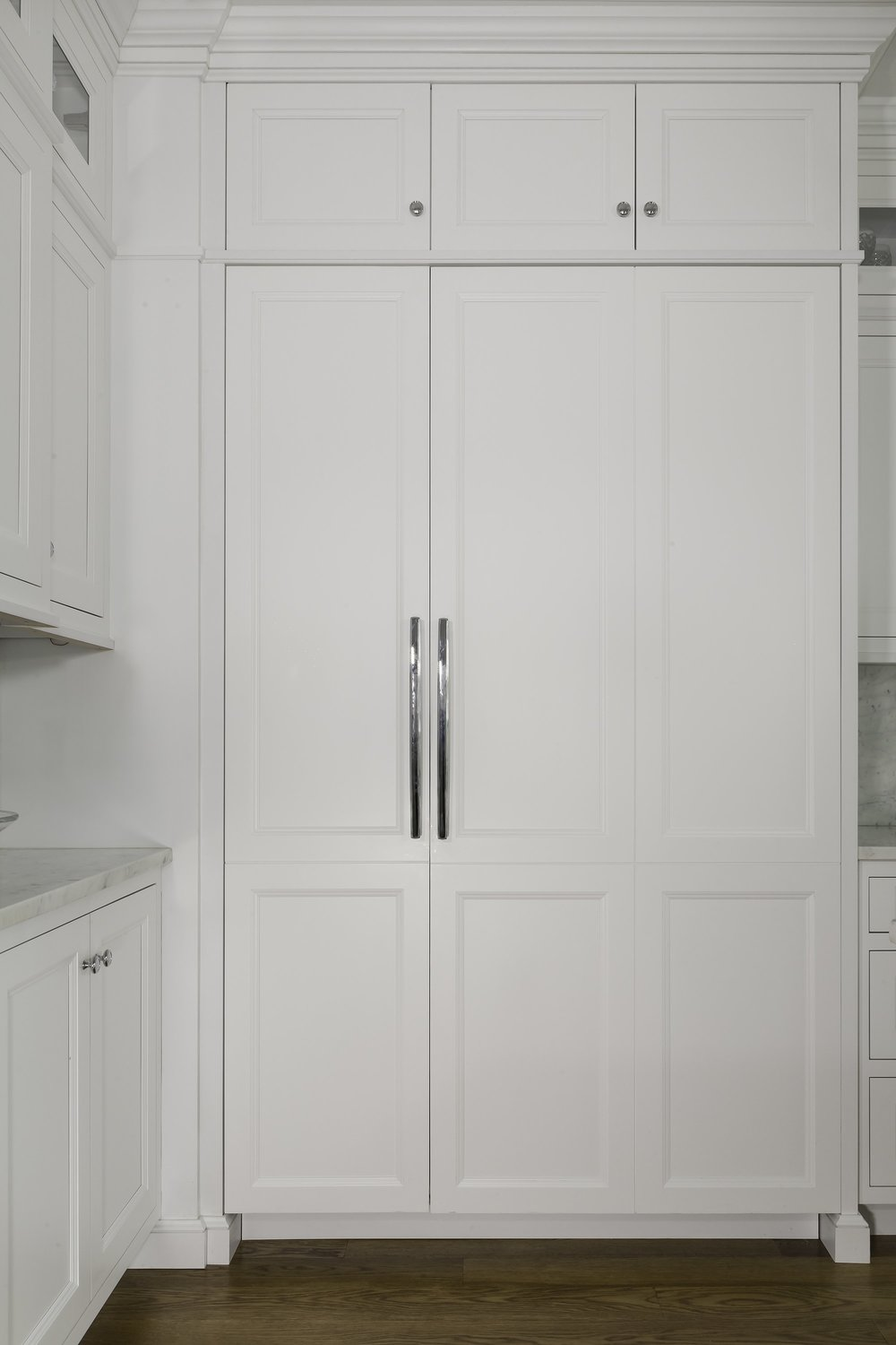 Transitional style kitchen with large white cabinet