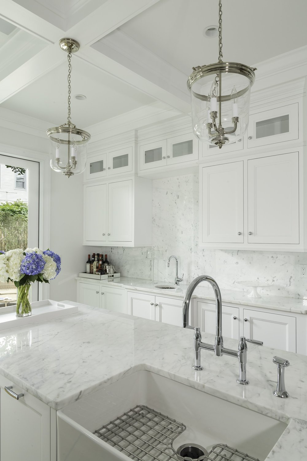 Transitional style kitchen with marble countertop and double hand faucet