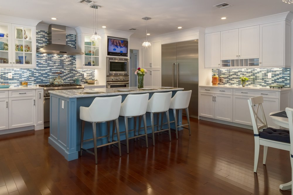 Transitional style kitchen with island in the center