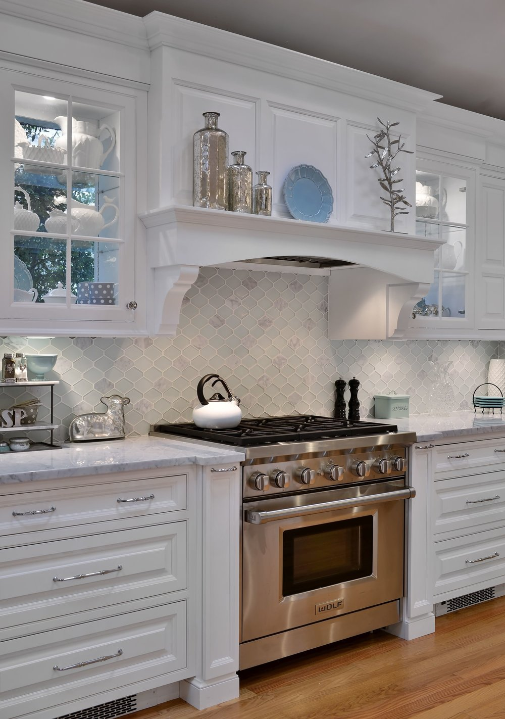 Transitional style kitchen with glass door cabinet and open shelf