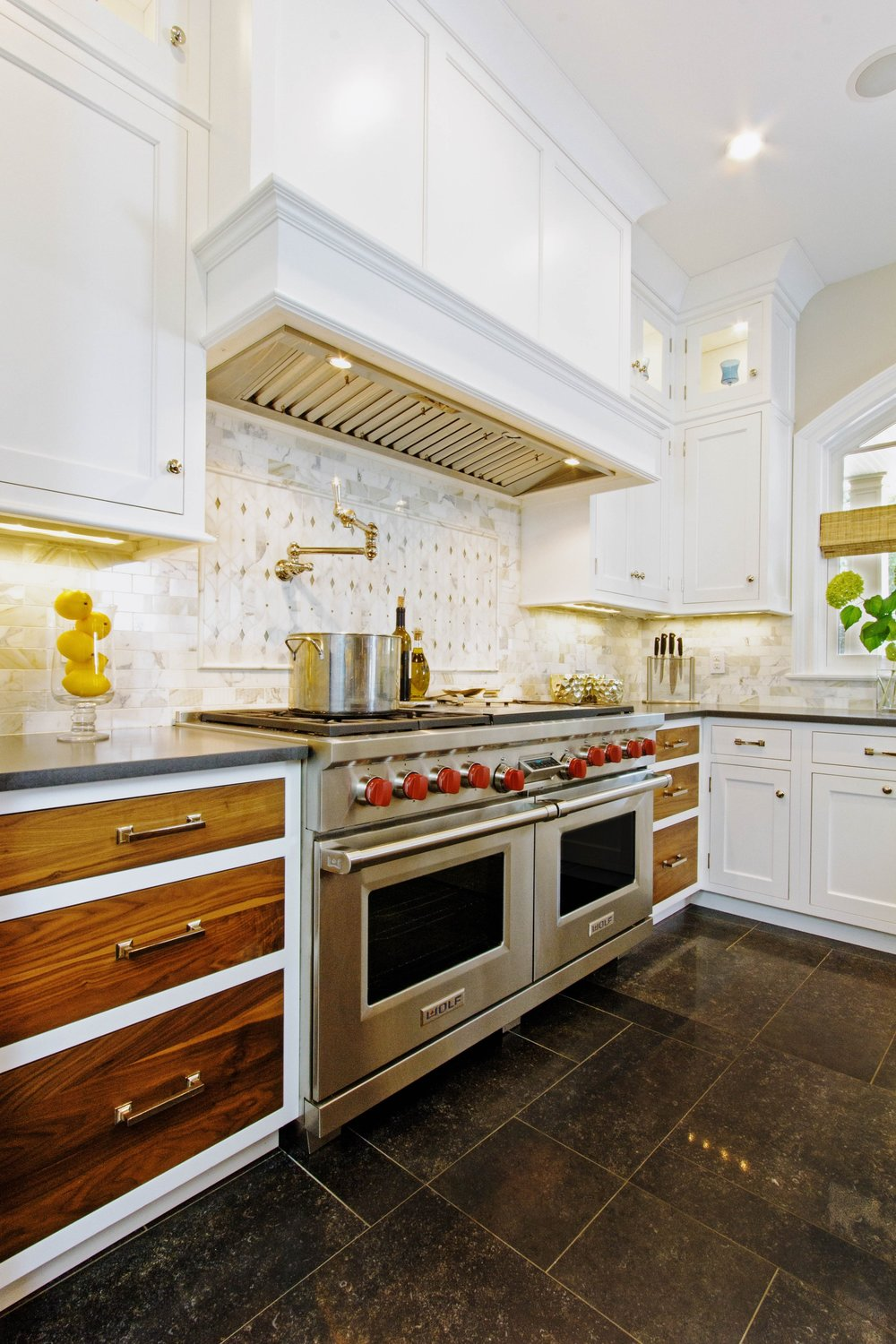 Transitional style kitchen with stainless steel range oven