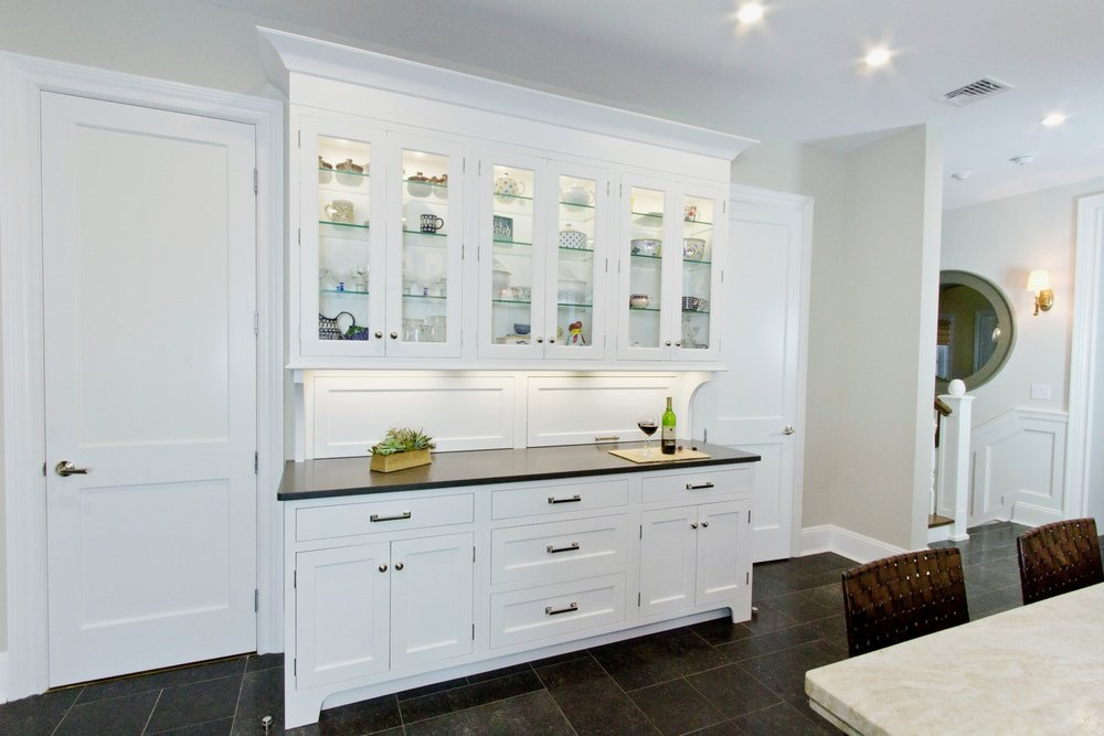 Transitional style kitchen with glass door cabinet