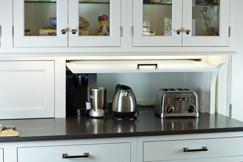 Transitional style kitchen with extra storage for small appliances
