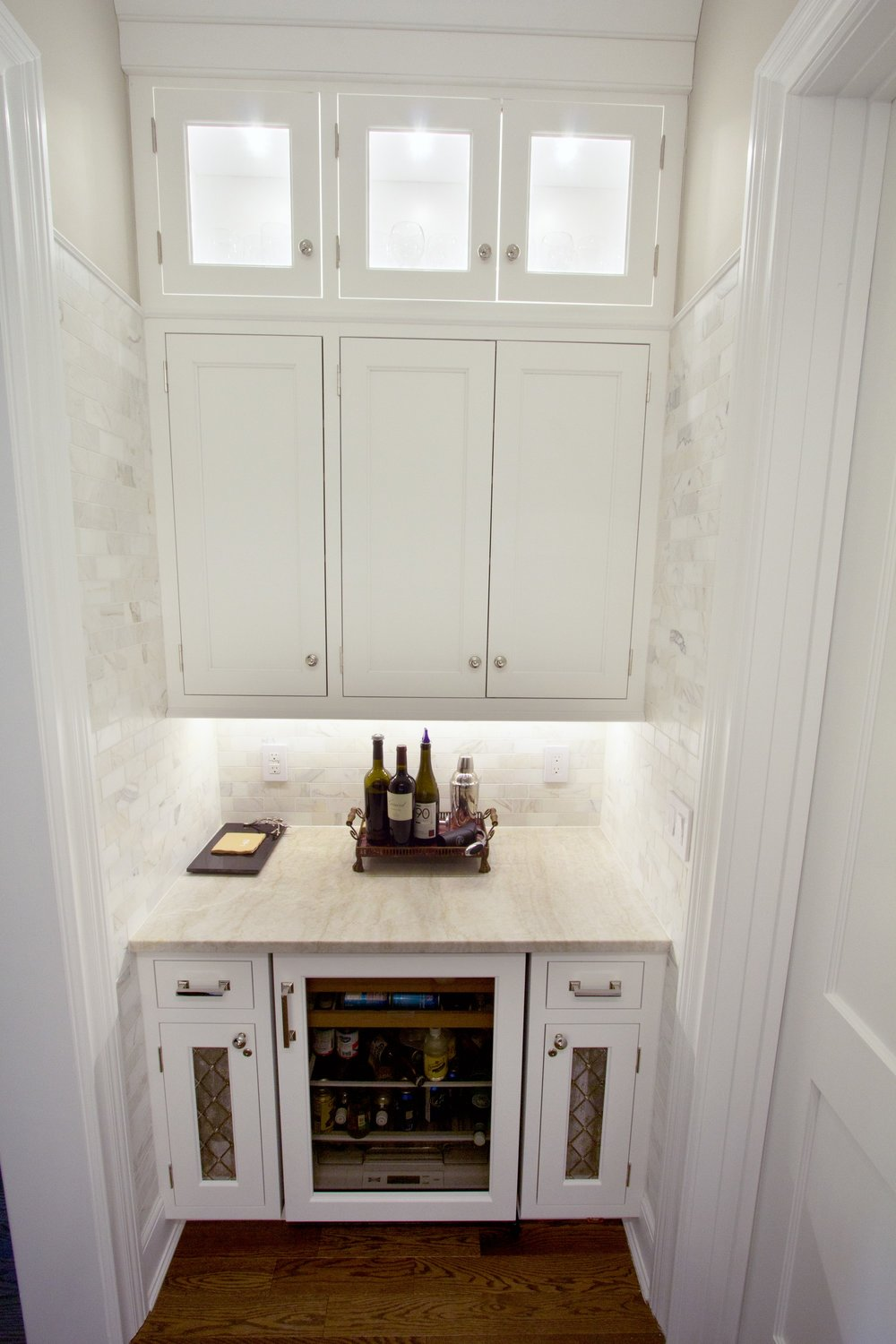 Transitional style kitchen with a small wine storage