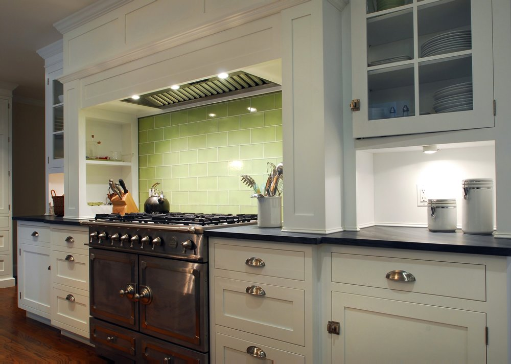 Transitional style kitchen with glass door upper cabinets