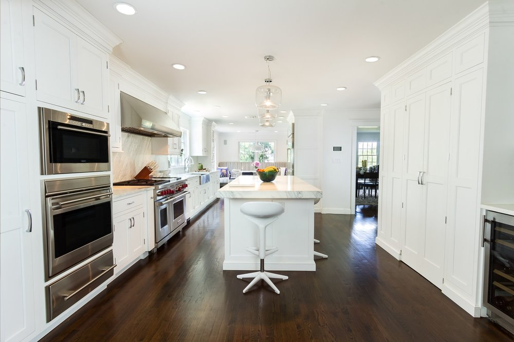 Transitional style kitchen with spacious and wooden floor