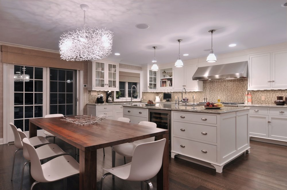 Transitional style kitchen with stylish light fixture