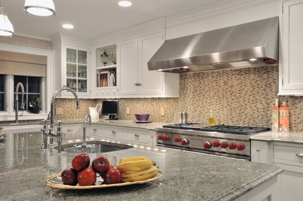 Transitional style kitchen with granite countertop